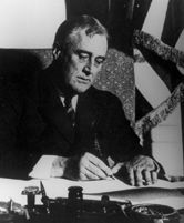 FDR signs Emergency Banking Act into law.