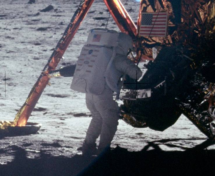 Neil Armstrong descending from the Lunar Module